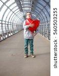 dreamy boy with red heart in... | Shutterstock . vector #560503255