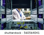 it engineer installs enclosure... | Shutterstock . vector #560564041