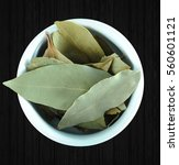 Small photo of Bay leaf, top view, isolated on black background