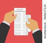 hand holding receipt.... | Shutterstock .eps vector #560617114