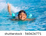 Boy happy swimming in a pool