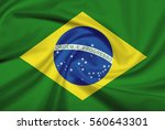 brazil flag with fabric texture.... | Shutterstock . vector #560643301