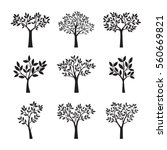 set of black trees and leafs.... | Shutterstock .eps vector #560669821
