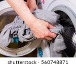A Woman Washes Laundry With Th...