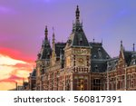 Stock photo beautiful view of the historic monument amsterdam central train station at sunset 560817391