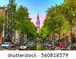 Stock photo beautiful groenburgwal canal in amsterdam with the soutern church zuiderkerk at sunset in summer 560818579