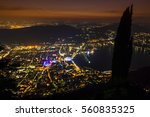 como city and lake from above... | Shutterstock . vector #560835325