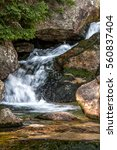 waterfall on a stream in the... | Shutterstock . vector #560837404