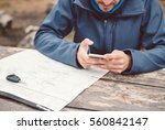 man on the nature with a phone... | Shutterstock . vector #560842147