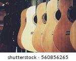 guitar music store with racks... | Shutterstock . vector #560856265