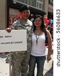 NEW YORK - JUNE 27: Grand Marshal Lieutenant Dan Choi with sister at the 2010 New York City Gay Pride March on the streets of Manhattan on June 27, 2010 in New York City. - stock photo