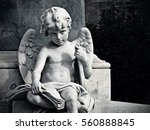 Angel Child Statue Holding A...