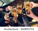 hands hold beverage beers... | Shutterstock . vector #560892721