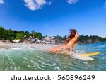 girl in bikini has fun on surf... | Shutterstock . vector #560896249