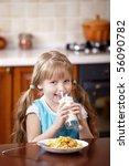 the little girl drinks milk for ... | Shutterstock . vector #56090782