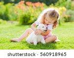 little girl with a labrador... | Shutterstock . vector #560918965