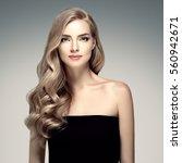 beautiful woman face close up... | Shutterstock . vector #560942671