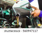 car mechanic replacing and... | Shutterstock . vector #560947117