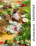 Small photo of Kelantan, Malaysia 24 June 2014 : Pasar Siti Khadijah or Kota Bharu Main Market in the morning with a lady seller with vegetables and fruits all around.