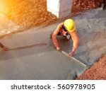 leveling concrete with trowels  ... | Shutterstock . vector #560978905
