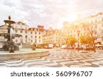 rossio square with fountain... | Shutterstock . vector #560996707