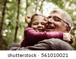 happy kid hugging grandfather... | Shutterstock . vector #561010021