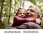 happy kid hugging grandfather... | Shutterstock . vector #561010021