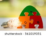 colorful jigsaw word law using... | Shutterstock . vector #561019351