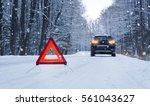 broken car and warning triangle ... | Shutterstock . vector #561043627