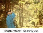 a young man birdwatching in the ... | Shutterstock . vector #561049951