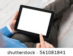 person using tablet computer | Shutterstock . vector #561081841