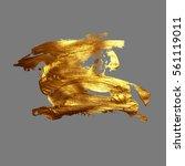 hand drawing gold brush stroke... | Shutterstock .eps vector #561119011