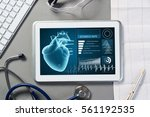white tablet pc and doctor... | Shutterstock . vector #561192535