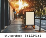 bus stop in city with empty... | Shutterstock . vector #561224161