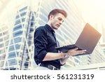 caucasian businessman use of... | Shutterstock . vector #561231319
