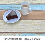 a cup of coffee and chocolate... | Shutterstock . vector #561241429