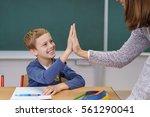 teacher and happy grinning... | Shutterstock . vector #561290041