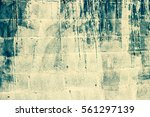 old stained white cement fence... | Shutterstock . vector #561297139