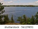 Motor boat on a lake - stock photo