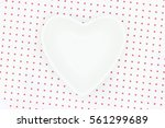 close up heart bowl on red... | Shutterstock . vector #561299689