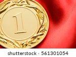 embossed gold winners medallion ... | Shutterstock . vector #561301054