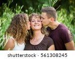 children kissing their mother.... | Shutterstock . vector #561308245