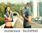 happy couple exercising...   Shutterstock . vector #561339565