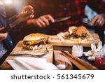 burger at restaurant. fast food ...   Shutterstock . vector #561345679