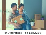 happy young couple unpacking or ... | Shutterstock . vector #561352219