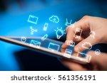 female hands touching tablet...   Shutterstock . vector #561356191