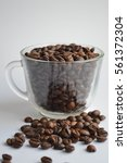 coffee beans in coffee cup....   Shutterstock . vector #561372304