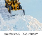 snow clearing. tractor clears... | Shutterstock . vector #561390589