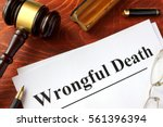 Small photo of Document with title Wrongful Death o a wooden surface.
