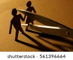 figures of couple from paper... | Shutterstock . vector #561396664